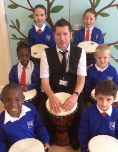 Phil Needham with year 3 African drummers